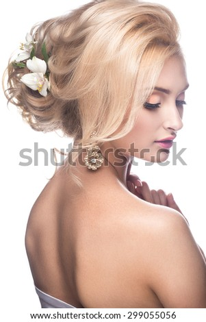Beautiful blond girl in the image of a bride with flowers. Beauty face. Wedding image. - stock photo