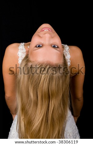 Beautiful blond girl looking at camera. Isolated on black - stock photo