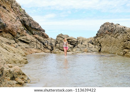 Beautiful blond girl meditate on the beach - stock photo