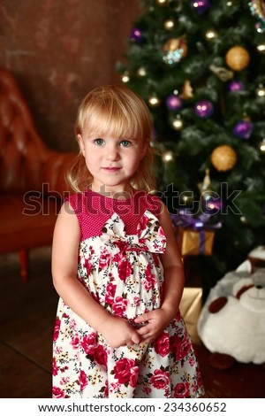beautiful blond girl near the christmas tree - stock photo