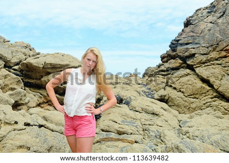 Beautiful blond girl  on the beach
