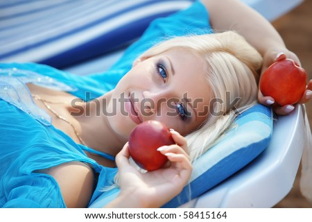 Beautiful blond girl relaxing on beach bad - stock photo