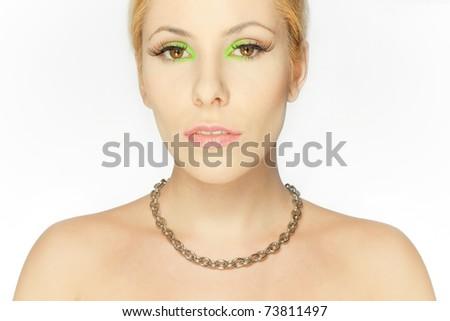 Beautiful blond girl with eyes make-up in green - stock photo