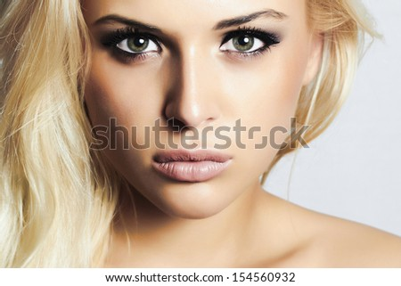beautiful blond girl with green eyes.beauty woman.professional make-up - stock photo