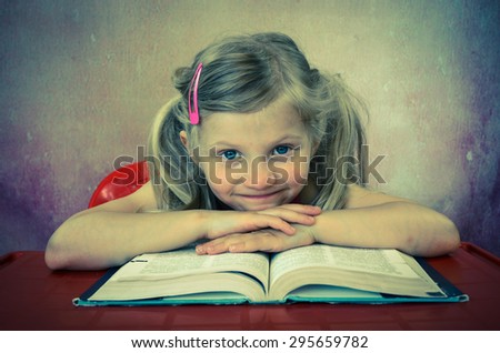 beautiful blond girl with open book - stock photo