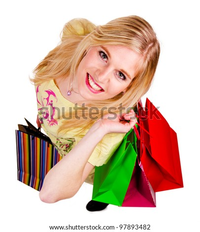 Beautiful blond girl with shopping bags, isolated on white background - stock photo