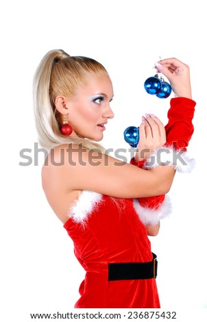 Beautiful blond in christmas costume holding balls