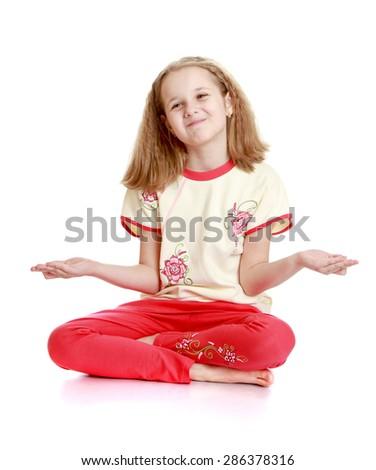 Beautiful blond little girl sitting on the floor meditating  - stock photo