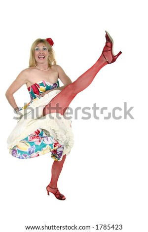 Beautiful blond middle aged woman performs the Can Can -Mesh stockings on legs and flower in hair. - stock photo