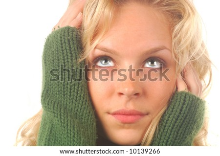 Beautiful blond model in green sweater on a white background. - stock photo