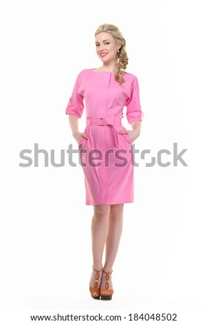 beautiful blond model in pink summer dress with plaited hair isolated on white