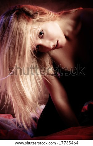 beautiful blond portrait in dark, studio shot - stock photo