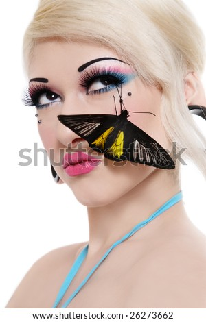 Beautiful blond sexy girl with bright makeup and black tropical butterfly on her face - stock photo