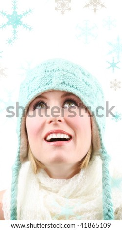 beautiful blond watches snowflakes falling