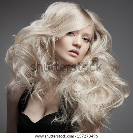 Beautiful Blond Woman. Curly Long Hair  - stock photo