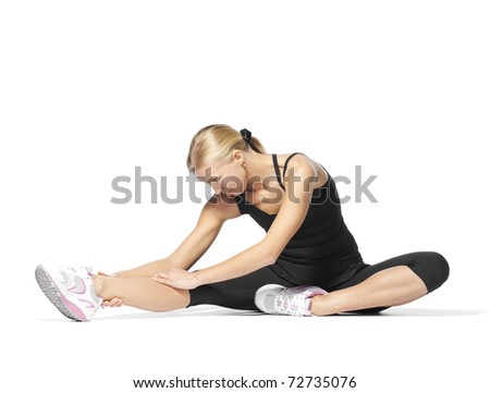 beautiful blond woman doing stretching sports exercises. fitness studio shot on white background - stock photo