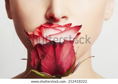 beautiful blond woman face and flower.girl and rose.close-up portrait.skin care.make-up - stock photo