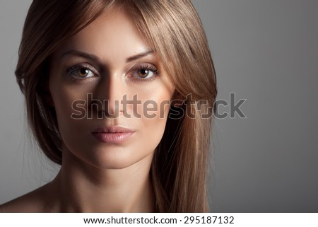 Beautiful Blond Woman. Healthy Long Hair. Make Up. - stock photo