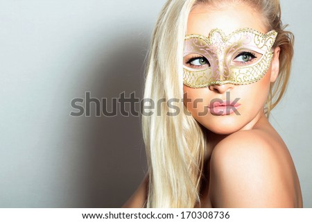 Beautiful Blond Woman in a Carnival Mask.Holiday Masquerade. Sexy Girl. Beauty & Fashion - stock photo