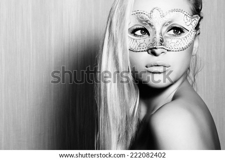 Beautiful Blond Woman in a Carnival Mask.Masquerade. Sexy Girl. art monochrome portrait.texture background - stock photo