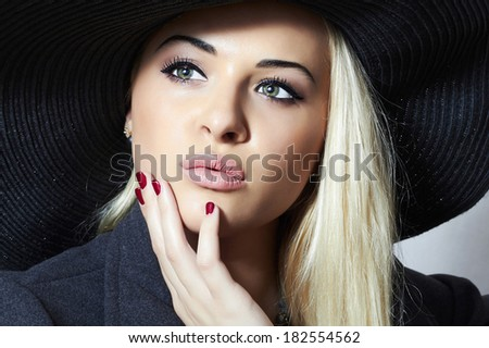 Beautiful Blond Woman in Black Hat. Fashionable Lady. Elegance Beauty Girl. Manicure - stock photo