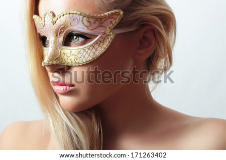 Beautiful Blond Woman in Carnival Mask.Masquerade. Sexy Girl. Beauty & Fashion - stock photo