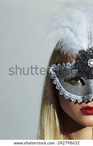Beautiful Blond Woman in Carnival Mask.Masquerade. Sexy Girl. Lovely.Holiday.Beauty & Fashion - stock photo