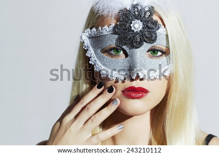Beautiful Blond Woman in Carnival Mask.Masquerade.Young Girl with red lips.Manicure Nail.Shellac - stock photo