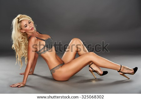 Beautiful blond woman in lingerie, glamour studio shot - stock photo