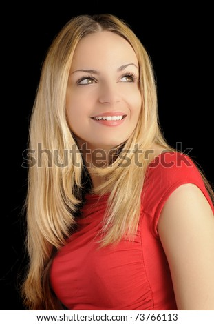 Beautiful blond woman in red shirt, layered hairstyle, smiling