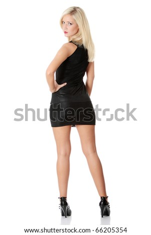 Beautiful blond woman in sexy elegant black dress, isolated on white background - stock photo