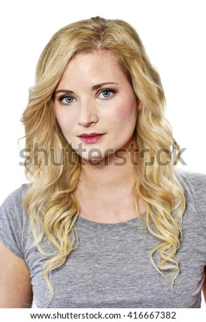 Beautiful blond woman looking into the camera. Young woman with copy space, isolated on white background.