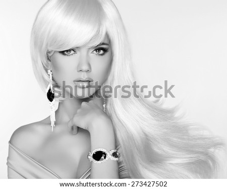 Beautiful blond woman model with long wavy hair. Luxury Jewelry. Glamour concept. Studio Fashion photo. - stock photo
