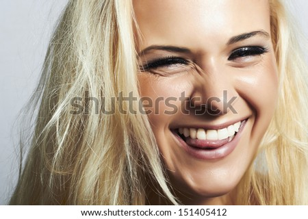 beautiful blond woman.mouth and white teeth.smile with tongue.happy crazy - stock photo