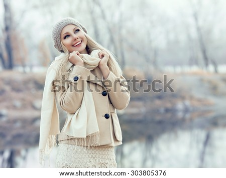 beautiful blond woman outdoor in the autumn park - stock photo