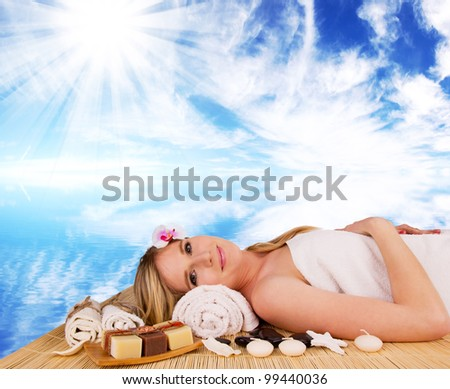 Beautiful blond woman relaxing - stock photo