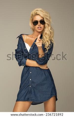 Beautiful blond woman wearing sunglasses - stock photo