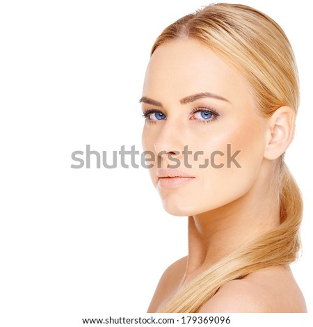 Beautiful blond woman with blue eyes and her long hair neatly coiled over a bare shoulder looking at the camera isolated on white with copyspace - stock photo