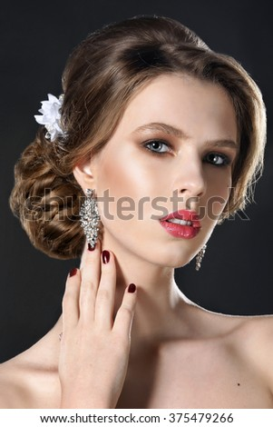Beautiful blond woman with evening make-up and hairstyle. Beauty face and perfect skin. - stock photo