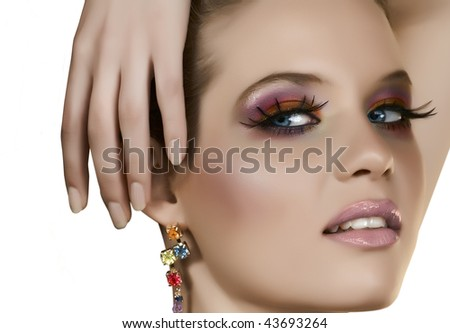 Beautiful blond woman with long fake lashes and seductive smile - stock photo