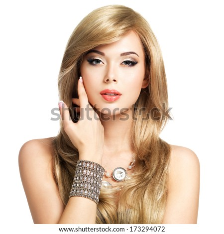 Beautiful blond woman with long hairstyle poses at studio - stock photo