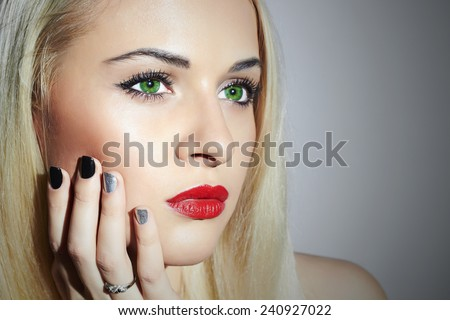 Beautiful blond Woman with Manicure.Beauty Girl. Nail design.Close-up portrait of young woman with red lips - stock photo
