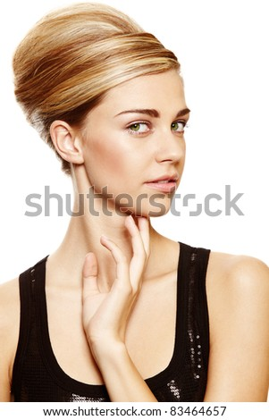 Beautiful blond woman with natural make-up wearing hair in a classic french roll updo hairstyle over white studio background . - stock photo