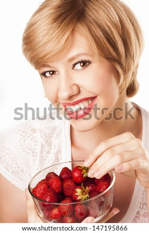 beautiful blond woman with strawberries isolated on white background