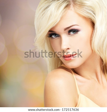 Beautiful blond woman with style hairstyle - stock photo