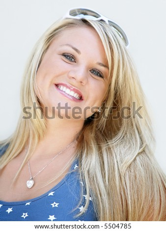 Beautiful blond young woman smiling