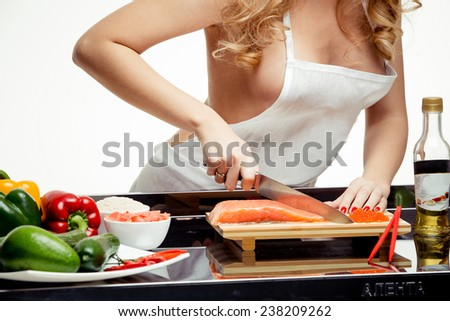 beautiful blonde at the table, preparing a meal