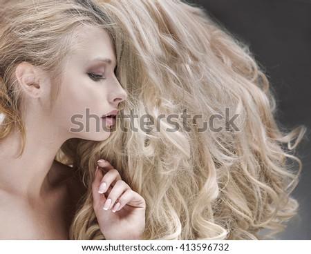 Beautiful blonde beauty with magnificent hair - stock photo