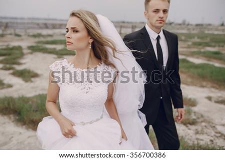 beautiful blonde couple celebrate their wedding - stock photo