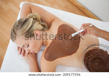 Beautiful blonde enjoying a chocolate beauty treatment at the health spa